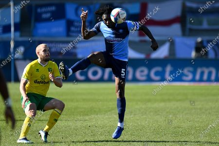 Wycombe Wanderers defender Anthony Stewart (5) heads the ball  during the EFL Sky Bet Championship match between Wycombe Wanderers and Norwich City at Adams Park, High Wycombe