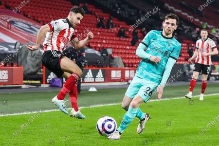 Sheffield United defender George Baldock (2) has his cross blocked by Liverpool defender Andy Robertson (26) during the Premier League match between Sheffield United and Liverpool at Bramall Lane, Sheffield