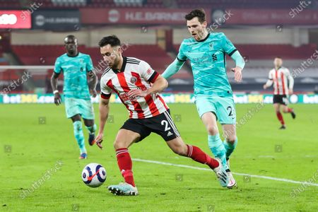 Stock Image of Sheffield United defender George Baldock (2) and Liverpool defender Andy Robertson (26) during the Premier League match between Sheffield United and Liverpool at Bramall Lane, Sheffield