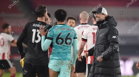 Manager Juergen Klopp (R), Trent Alexander-Arnold (C) and goalkeeper Adrian (L) of Liverpool celebrate after winning the match during the English Premier League soccer match between Sheffield United and Liverpool FC in Sheffield, Britain, 28 February 2021.