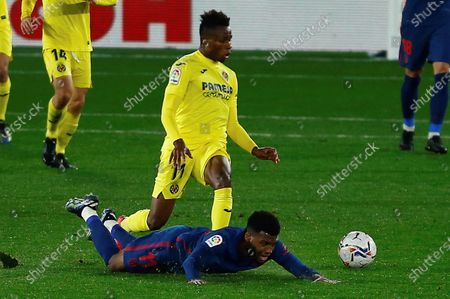 Villarreal's Samuel Chukwueze (top) in action against Atletico Madrid's Thomas Lemar during a Spanish LaLiga soccer match between Villarreal CF and Atletico Madrid at Ceramica stadium in Villarreal, Castellon, eastern Spain, 28 February 2021.