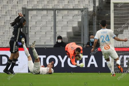 Lyon's goalkeeper Anthony Lopes makes a save during the French League One soccer match between Marseille and Lyon at the Stade Veledrome stadium in Marseille, France