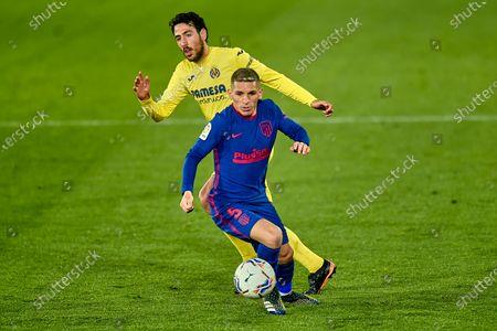 Lucas Torreira of Atletico de Madrid and Daniel Parejo of Villarreal CF