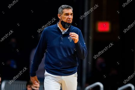 Villanova head coach Jay Wright on the bench in the second half of an NCAA college basketball game against Butler in Indianapolis