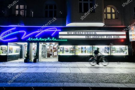 The Eva Lichtspiele cinema is illuminated on the occasion of the event 'Cinema lights up. For you' (Kino leuchtet. Fuer Dich) in Berlin, Germany, 28 February 2021, a day before the official start of the 71st Berlinale, which this year is a virtual event running from 01 to 05 March. The cinema operators event aims to draw attention for the situation of the still closed cinemas in Germany, due to restrictions of the coronavirus pandemic.