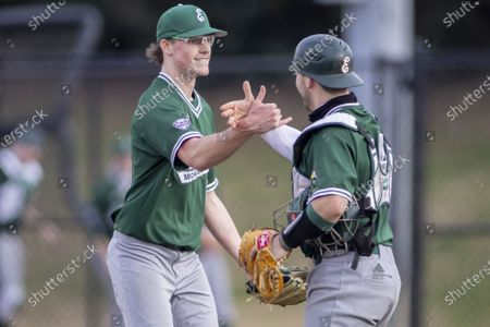 Eastern Michigan pitcher Cameron Wagoner, left, celebrates with catcher/infielder Nick Jones after a 4-3 win over Alabama State during an NCAA baseball game, in Montgomery, Ala