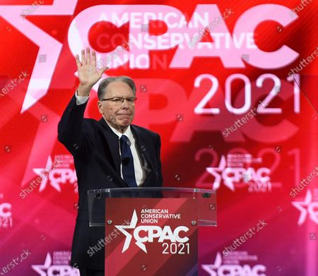 Wayne LaPierre, Executive Vice President of the National Rifle Association, waves after speaking at the 2021 Conservative Political Action Conference at the Hyatt Regency where former President Trump is scheduled to speak.