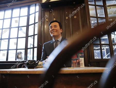 A wax figure of Jimmy Fallon fills a seat at a table when Madame Tussauds Wax Figures join restaurant diners at Peter Luger Steak House in New York City on Sunday, February 28, 2021. The celebrity wax figures will remain at the Williamsburg location until Monday, March 1.