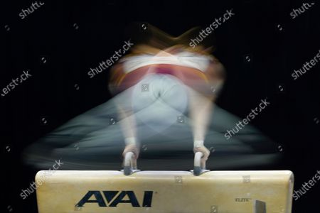 Michael Moran performs on the pommel horse during the Winter Cup gymnastics competition, in Indianapolis