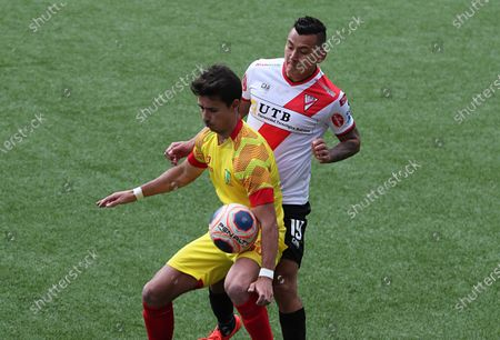 Enrique Flores (R) of Always Ready in action against Jaime Santos of PalmaFlor Vinto, during a friendly match for the presentation of the Always Ready 2021 team in El Alto, Bolivia, 28 February 2021.
