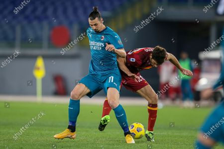 Zlatan Ibrahimovic of AC Milan challenges Federico Fazio of AS Roma during the Italian Serie A football match between AS Roma and AC Milan at Olimpico Stadium in Rome, Italy on February 28, 2021. AC Milan won the match 2-1.