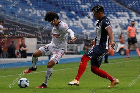 Jesus Gallardo (R) of Monterrey in action against Jaime Gomez of Club Tijuana during a Liga MX soccer match at the BBVA Bancomer Stadium in Monterrey, Mexico, 28 February 2021.