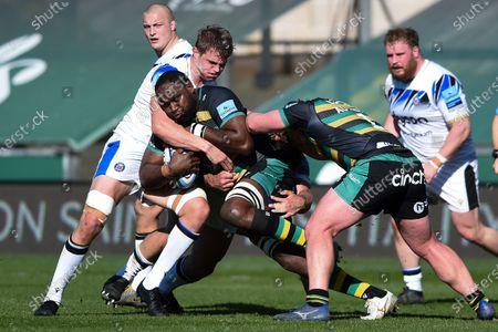 Api Ratuniyarawa of Northampton Saints is tackled by Tom Ellis of Bath Rugby