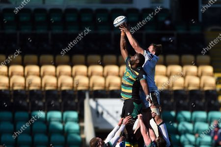 Tom Ellis of Bath Rugby and Api Ratuniyarawa of Northampton Saints compete for the ball at a lineout