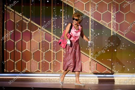 Handout image released by the Hollywood Foreign Press Association showing Kristen Wiig presents the award for Best Motion Picture - Musical or Comedy during the 78th annual Golden Globe Awards ceremony at the Beverly Hilton Hotel, in Beverly Hills, California, USA, 28 February 2021.