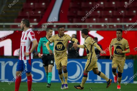 Gabriel Torres (C) of Pumas of UNAM celebrates after scoring against Chivas during a Guardians 2021 tournament soccer match at the Akron stadium in Guadalajara, Mexico, 28 February 2021.