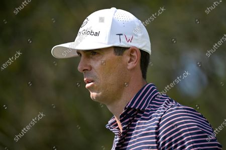 Billy Horschel displays the TW initials honoring Tiger Woods while walking on the first hole during the final round of the Workday Championship golf tournament, in Bradenton, Fla