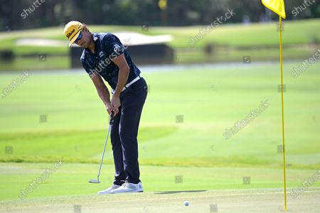 Stock Image of Rafa Cabrera Bello, of Spain, watches his putt on the 12th green during the final round of the Workday Championship golf tournament, in Bradenton, Fla
