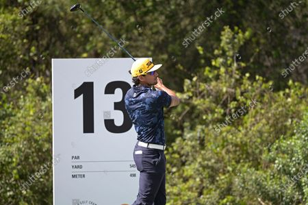 Rafa Cabrera Bello, of Spain, watches his tee shot on the 13th hole during the final round of the Workday Championship golf tournament, in Bradenton, Fla