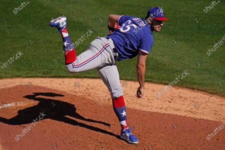 Texas Rangers pitcher Joe Gatto throws during the fifth inning of a spring training baseball game against the Kansas City Royals, in Surprise, Ariz