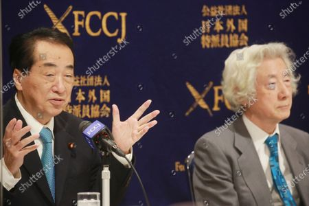 """Japan's former Prime Ministers Naoto Kan gestures as Junichiro Koizumi listens during their joint press conference on the theme of """"Ten years after Fukushima - Nuclear power in Japan"""" in Tokyo"""