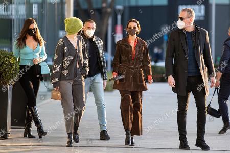 Irina Shayk, Gigi Hadid and Bella Hadid are leaving the Versace's headquarters