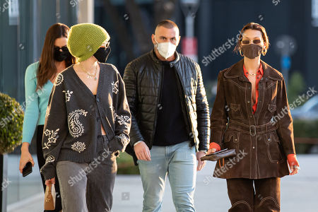 Gigi Hadid and Bella Hadid leaving the Versace's headquarters
