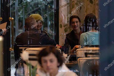 Bella Hadid and Gigi Hadid dining at a restaurant in Milan during Milan Fashion Week