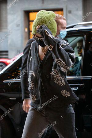 Gigi Hadid arriving to a restaurant in Milan during Milan Fashion Week
