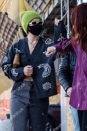 Gigi Hadid is arriving to Versace's headquarters