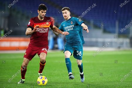 Federico Fazio of Roma (L) vies for the ball with Alexis Saelemaekers of Milan (R)