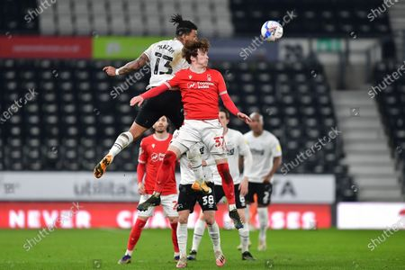 James Garner (37) of Nottingham Forest battles with Colin Kazim-Richards of Derby County during the Sky Bet Championship match between Derby County and Nottingham Forest at the Pride Park, Derby on Friday 26th February 2021.  (Photo by Jon Hobley/MI News/NurPhoto)
