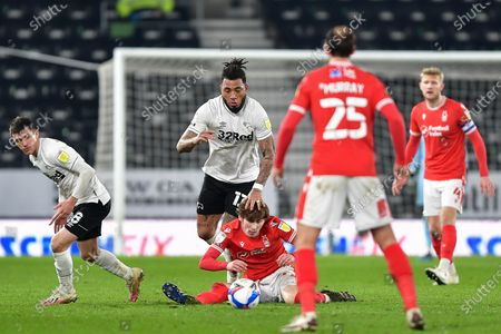 Colin Kazim-Richards of Derby County holds down James Garner (37) of Nottingham Forest during the Sky Bet Championship match between Derby County and Nottingham Forest at the Pride Park, Derby on Friday 26th February 2021.  (Photo by Jon Hobley/MI News/NurPhoto)