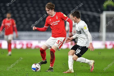 James Garner (37) of Nottingham Forest battles with Jason Knight of Derby County during the Sky Bet Championship match between Derby County and Nottingham Forest at the Pride Park, Derby on Friday 26th February 2021.  (Photo by Jon Hobley/MI News/NurPhoto)