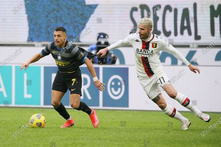 Alexis Sanchez of FC Internazionale competes for the ball with Valon Behrami of Genoa CFC during the Serie A match between FC Internazionale and Genoa CFC at Stadio Giuseppe Meazza on February 28, 2021 in Milan, Italy. Sporting stadiums around Italy remain under strict restrictions due to the Coronavirus Pandemic as Government social distancing laws prohibit fans inside venues resulting in games being played behind closed doors. (Photo by Giuseppe Cottini/NurPhoto)