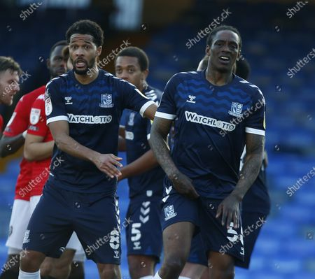 Stock Image of L-R Timothee Dieng of Southend United and  Nile Ranger of Southend United during Sky Bet League Two between Southend United and Salford City at Roots Hall Stadium , Southend, UK on 27th February 2021  (Photo by Action Foto Sport/NurPhoto)