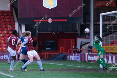Lisa Evans (#17 Arsenal) scores against Lisa Weiss (#29 Aston Villa) during the FA Womens Super League match between Aston Villa and Arsenal at Banks's Stadium in Walsall, England.