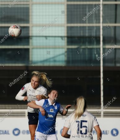 Lauren Hemp (#15 Manchester City) watches on as Alex Greenwood (#27 Manchester City) heads the ball during the Barclays FA Women's Super League game between Birmingham City and Manchester City at St. George's Park in Burton upon Trent, England.