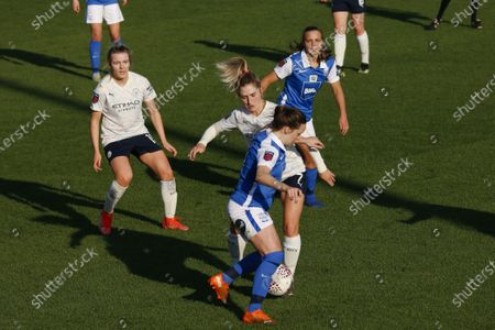 Laura Coombs (#7 Manchester City) looks to tackle Harriet Scott (#3 Birmingham City) during the Barclays FA Women's Super League game between Birmingham City and Manchester City at St. George's Park in Burton upon Trent, England.