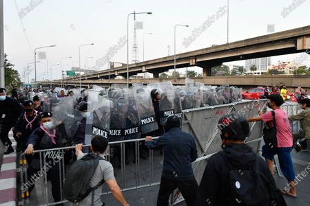 Riot police officers face off against with protesters during a rally in Bangkok as marching toward the residence of Thailand's Prime Minister Prayut Chan-O-Cha on February 28, 2021 in Bangkok, Thailand. (Photo by Vachira Vachira/NurPhoto)