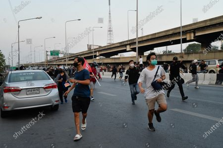 Anti-government protesters run away as riot police crack down on protesters during a rally in Bangkok as marching toward the residence of Thailand's Prime Minister Prayut Chan-O-Cha on February 28, 2021 in Bangkok, Thailand.  (Photo by Vachira Vachira/NurPhoto)