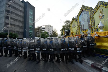 Riot police officers stand guard during a rally in Bangkok as marching toward the residence of Thailand's Prime Minister Prayut Chan-O-Cha on February 28, 2021 in Bangkok, Thailand.   (Photo by Vachira Vachira/NurPhoto)