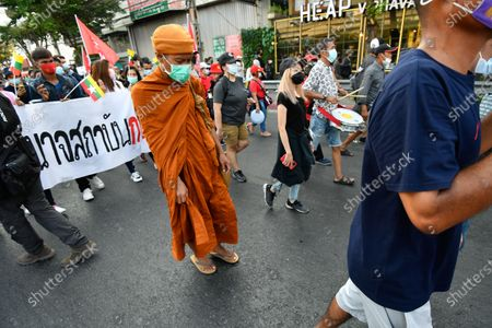 A Buddhist monk takes part in a rally protest during a rally in Bangkok as marching toward the residence of Thailand's Prime Minister Prayut Chan-O-Cha on February 28, 2021 in Bangkok, Thailand. (Photo by Vachira Vachira/NurPhoto)