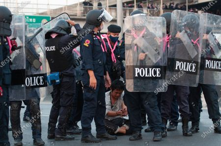 An anti-government protester is seen detained by riot police officers during a rally in Bangkok as marching toward the residence of Thailand's Prime Minister Prayut Chan-O-Cha on February 28, 2021 in Bangkok, Thailand.  (Photo by Vachira Vachira/NurPhoto)