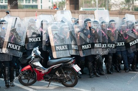 Riot police officers walk in formation during a rally in Bangkok as marching toward the residence of Thailand's Prime Minister Prayut Chan-O-Cha on February 28, 2021 in Bangkok, Thailand.  (Photo by Vachira Vachira/NurPhoto)