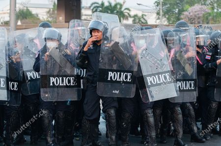 Stock Image of Riot police officers walk in formation during a rally in Bangkok as marching toward the residence of Thailand's Prime Minister Prayut Chan-O-Cha on February 28, 2021 in Bangkok, Thailand.  (Photo by Vachira Vachira/NurPhoto)