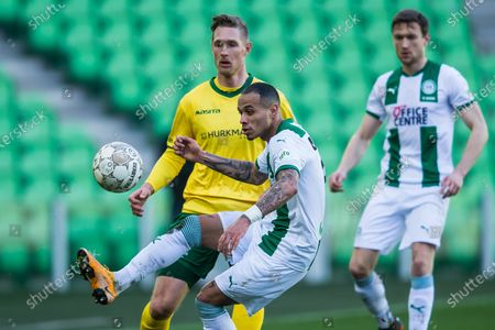 (lr) Sebastian Polter of Fortuna Sittard, Damil Dankerlui or FC Groningen during the Dutch Eredivisie match between FC Groningen and Fortuna Sittard at the Hitachi Capital Mobility stadium on February 28, 2021 in Groningen, The Netherlands.