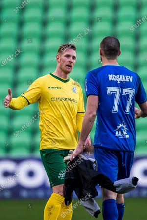 (lr) Sebastian Polter of Fortuna Sittard, goalkeeper Alexei Koselev or Fortuna Sittard during the Dutch Eredivisie match between FC Groningen and Fortuna Sittard at the Hitachi Capital Mobility stadium on February 28, 2021 in Groningen, The Netherlands.