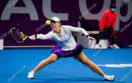Saisai Zheng of China in action during her first-round match at the 2021 Qatar Total Open WTA 500 tournament