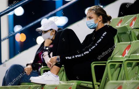 Karolina Pliskova of the Czech Republic watches sister Kristyna at the 2021 Qatar Total Open WTA 500 tournament